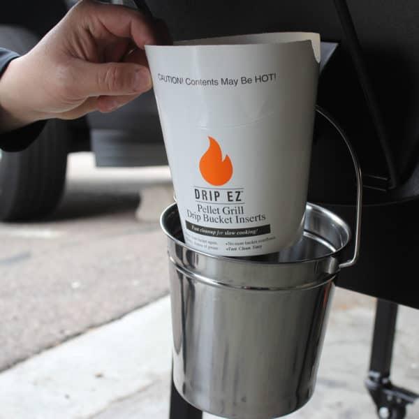 Person putting GMG Drip-EZ Bucket Liner into bucket
